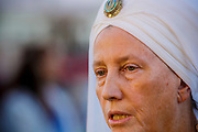 07 AUGUST 2012 - PHOENIX, AZ:  Gurukirn Kaur Khalsa, a leader in the Sikh community in Phoenix, talks about the massacre at a Sikh temple in Wisconsin over the weekend. She was attending a prayer service at the Arizona Interfaith Movement. Arizona Interfaith Movement consists of 25 different faith traditions. They hosted an interfaith Prayer Circle Tuesday night where attendees offered moments of prayer in their own faith tradition for the victims of the massacre at the Sikh temple in Wisconsin last Sunday. About 60 people attended the service.     PHOTO BY JACK KURTZ