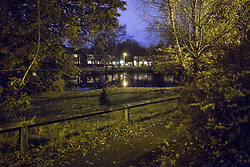 © Licensed to London News Pictures . 02/12/2013 . Bramhall , Stockport , UK . General view of the pond . Police and forensic scenes of crime investigators work at the scene where the dead body of a teenaged boy was pulled from a pond off Brent Moor Road , today (2nd December 2013) . Photo credit : Joel Goodman/LNP