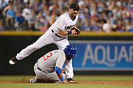 Aug 11, 2017; Phoenix, AZ, USA; Arizona Diamondbacks outfielder Daniel Descalso (3) makes the force out on the sliding Chicago Cubs catcher Alex Avila (13) in the fourth inning at Chase Field. Mandatory Credit: Jennifer Stewart-USA TODAY Sports