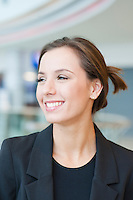 Smiling businesswoman looking off camera