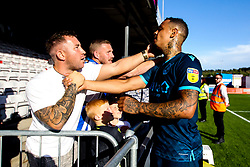 Jonson Clarke-Harris of Bristol Rovers celebrates with fans after beating Lincoln City - Mandatory by-line: Robbie Stephenson/JMP - 14/09/2019 - FOOTBALL - Sincil Bank Stadium - Lincoln, England - Lincoln City v Bristol Rovers - Sky Bet League One