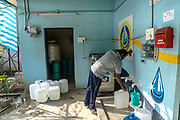A customer fills a water can at a Safe Water Network iJal station in Rangsaipet, in Waragal, Telangana, Indiia, on Sunday, February 10, 2019. Photographer: Suzanne Lee for Safe Water Network