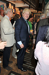 Mayor of London BORIS JOHNSON at a party to celebrate the publication of Stanley Johnson's new book 'Where The Wild Things Were' held at Daunt Books, 83 Marylebone High Street, London W1 on 18th July 2012.