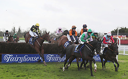 Runners and riders clear the first during the Mongey Communications Beginners Steeplechase during The Easter Tuesday Meeting at Fairyhouse, Ratoath.
