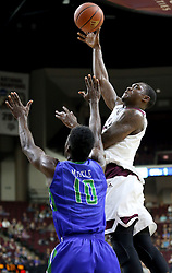 Texas A&M's Jalen Jones (12) makes a basket against Florida Gulf Coast University's Kevin Mickle (10) during a NCAA college basketball game in College Station, Texas, Wednesday, Dec. 2, 2015.  (AP Photo/Sam Craft)