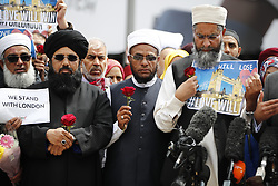 © Licensed to London News Pictures. 07/06/2017. London, UK. Imams and various religious leaders visit the scene of attack on London Bridge and leave flowers for the victims after Saturday night's terror attack that killed 8 people on London Bridge and at Borough Market in central London. Photo credit: Tolga Akmen/LNP