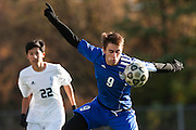 Mount Anthony's Carter Bentley (9) heads the ball during the quarterfinal boys soccer game between Mount Anthony and Burlington at Buck Hard Field on Friday afternoon October 23, 2015 in Burlington. (BRIAN JENKINS/ for the FREE PRESS)