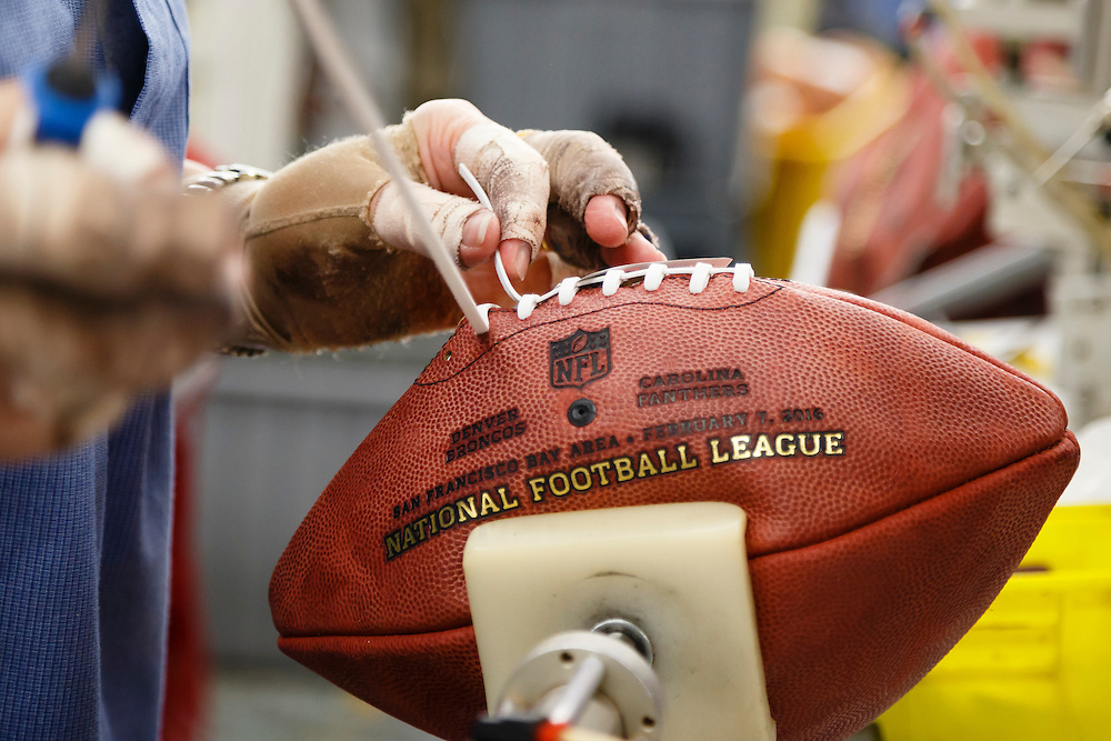 Donna Conley laces an official ball for the NFL Super Bowl 50 football game at the Wilson Sporting Goods Co. in Ada, Ohio, Tuesday, Jan. 26, 2016. The Denver Broncos will play the Carolina Panthers in the Super Bowl on Feb. 7 in Santa Clara, CA. (AP Photo/Rick Osentoski)