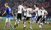 Valencia celebrate after scoring a goal  during the UEFA Champions League round of 16 second leg match between Schalke 04 and Valencia at Veltins Arena on March 9, 2011 in Gelsenkirchen, Germany.