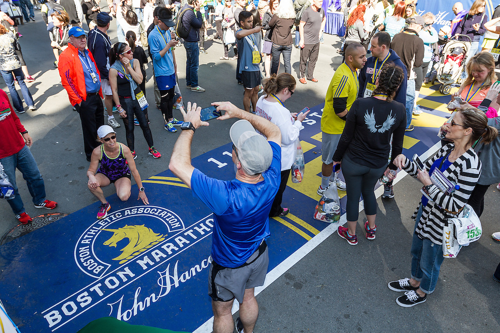 Boston Marathon: BAA 5K road race, fans take pictures at marathon finish line