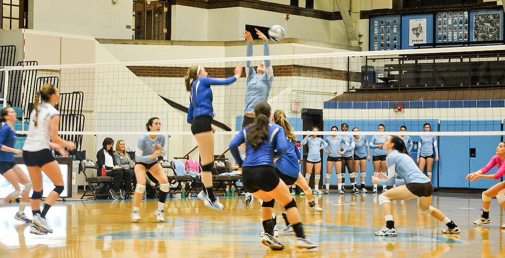 10/18/2013 - Cousens Gym, Tufts Medford campus - Tufts junior, Isabel Kuhel, middle and opposite hitter, leaps for the ball during the volleyball home game where Tufts defeats Hamilton 25-12. Caroline Geiling / The Tufts Daily