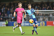Wycombe Wanderers Midfielder, Scott Kashket (24) goalscorer and Hartlepool United Defender, James Martin (29) during the EFL Sky Bet League 2 match between Wycombe Wanderers and Hartlepool United at Adams Park, High Wycombe, England on 26 November 2016. Photo by Adam Rivers.