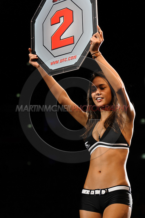 """COLOGNE, GERMANY, JUNE 13, 2009: UFC """"Octagon Girl"""" Logan Stanton walks on the cage apron during """"UFC 99: The Comeback"""" inside LanXess Arena, Cologne"""