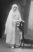 girl posing to commemorate her holy communion 1920s