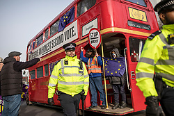 """© Licensed to London News Pictures. 29/01/2019. London, UK. A pro-Brexit protester shouts at anti-Brexit demonstrators on a """"battle bus"""" calling for a second vote on Brexit. MPs will vote on a series of amendments this evening. Photo credit: Rob Pinney/LNP"""