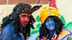 © Licensed to London News Pictures. 05/09/2015. Watford, UK. (L to R) Local schoolboys, Hrithik and Paavan, dress up for the day as Kans (Krishna's enemy) and Lord Krishna respectively, during their visit to the biggest Janmashtami festival outside of India at the Bhaktivedanta Manor Hare Krishna Temple in Watford, Hertfordshire.  The event celebrates the birth of Lord Krishna and the festival  includes music, dance, food, dramas and more. Photo credit : Stephen Chung/LNP