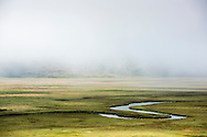Looking down on Flat Creek in the morning fog in the National Elk Refuge outside Jackson, WY. ©Brett Wilhelm