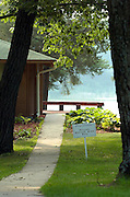 PRIVATE RETREAT -- A lawn sign indicates a private retreat hermitage, known as a Poustinia, at the Redemptorist Retreat Center on Crooked Lake near Oconomowoc. The hermitage is available to individuals seeking to encounter God in solitude, silence and prayer. (Photo by Sam Lucero)