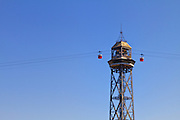 Spain, Barcelona. The center tower (Torre Jaume I) of the Port Vell Aerial Tramway that crosses the port of Barcelona a distance of nearly a mile. The tower rises just over 350 feet above the port.