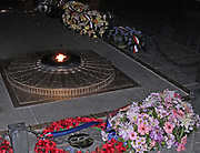 eternal flame at the Memorial to the dead at the Arche de La triomphe (Arc de Triomphe), Paris, France