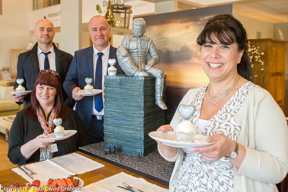 Left to right Events Fundraiser Ash Corker, Rotherham Hospice Fundraising Team Leader Anne Giblin, Oak Furniture Land Rotherham Store Manager Jez Groom and Cake Artist Rose Dummer enjoy a Celebration Breakfast with Man of Steel at the opening of the Oak Furniture Land Rotherham Store. The cake will be donated to Rotherham Hospice who will use it to help raise funds<br /> <br /> 3 June 2015<br />  Image © Paul David Drabble <br />  www.pauldaviddrabble.co.uk