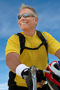 Smiling Man Out for a Bicycle Ride
