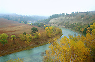 Niobrara Wild and Scenic Riverway, Nebraska Sandhills.  A snow squall moves in from the north over the Niobrara river in October. Located along the northern edge of the Nebraska sandhills, the Niobrara river has been described as the biological crossroads of the Great Plains where several different major forest and grassland types meet and are at the limits of their ranges. Protected because of its unique natural history and scenic beauty, the Niobrara is the only remaining west to east running river in the Plains without a major dam or diversion along its reach.