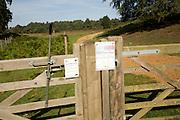 Conservation grazing notice signs on fence, Shottisham, Suffolk Sandlings, England