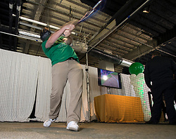 Clayton Career of Brentwood, Calif. swings for the virtual fences at a VR home run exhibit during Oakland Athletics FanFest at Jack London Square on Saturday, Jan. 27, 2018 in Oakland, Calif. (D. Ross Cameron/SF Chronicle)
