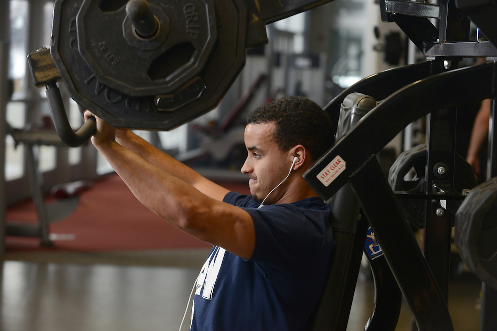 A student works out on the second floor the Student Recreation and Wellness Center.