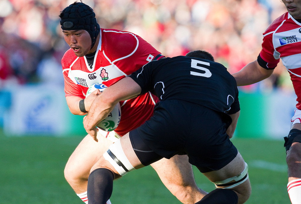 Japan's Kensuke Hatakeyama is tackled by Canada's Jamie Cudmore at the pool match 2011 Rugby World Cup, McLean Park, Napier, New Zealand, Tuesday September27, 2011.  Credit: SNPA / Bethelle McFedries