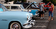 """Pam (right) and Dave Potter of Huber Heights look at .a 1957 Chevy wagon during the Spectacular Summer Cruise-In & Concert at the Miami Valley Centre Mall in Piqua, July 2, 2011  Dave told us """"I have a Ford Falcon I've restored."""""""