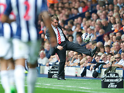 WEST BROMWICH, ENGLAND - Saturday, August 18, 2012: Liverpool's manager Brendan Rodgers kicks the ball back during the opening Premiership match of the season against West Bromwich Albion at the Hawthorns. (Pic by David Rawcliffe/Propaganda)