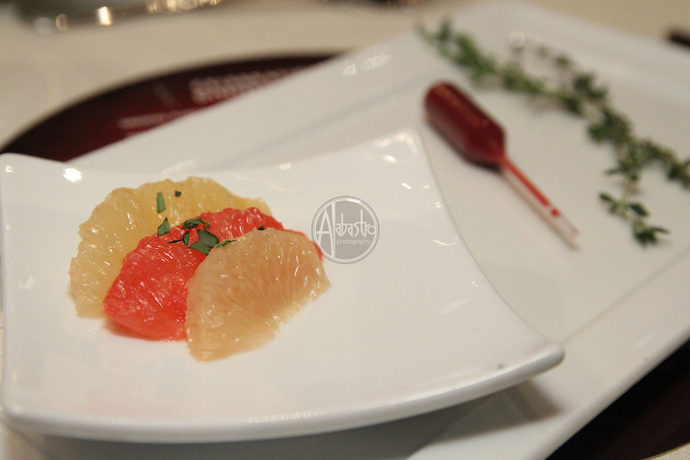 2011 Taste of Tulalip Celebration Dinner. Ruby Pink Grapefruit Segments, Sprig of Tyme and Blood Orange Reduction Pipette.