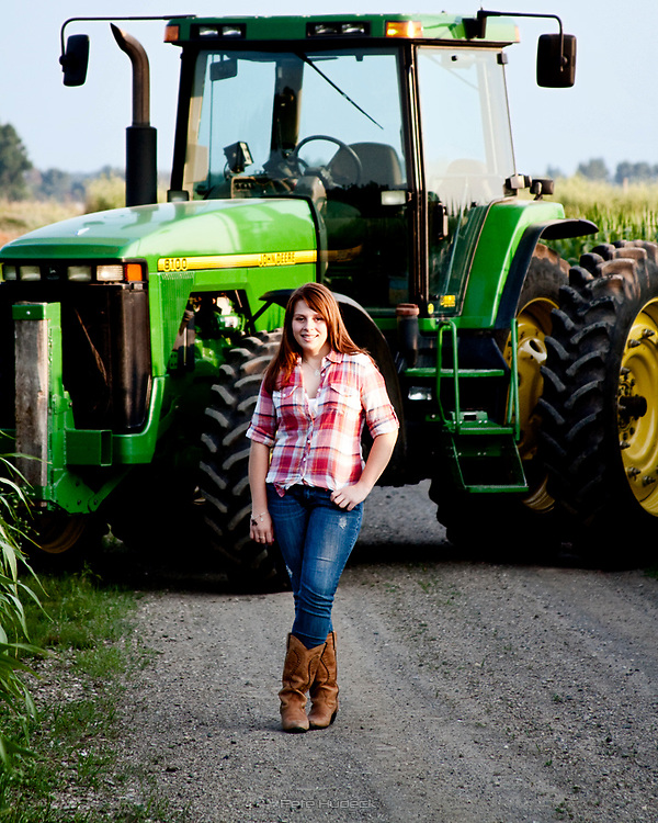 High School Senior in front of a John Deere Tractor