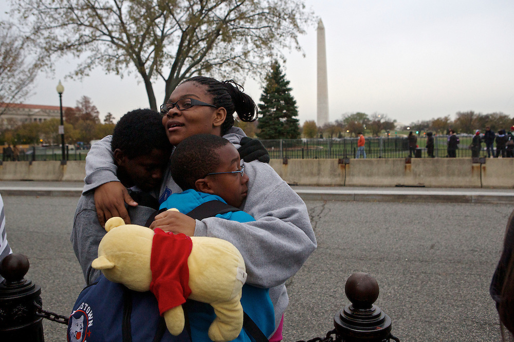 Nigil Breweington, 13, from left, Latoya Strachan, 14, and Kevin Patterson, 13, try to stay warm in front of the White House during their eighth-grade field trip Wednesday, Nov. 7, 2012 in Washington, D.C. The students from Port Chester Middle School in Port Chester, NY, held a mock election on election day where they said Pres. Obama was the overwhelming winner, according to their English Language Arts teacher, Brenda Burke.