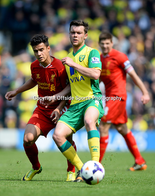 20 April 2014 - Barclays Premier League - Norwich City v Liverpool - Philippe Coutinho of Liverpool tangles with Jonny Howson of Norwich City - Photo: Marc Atkins / Offside.