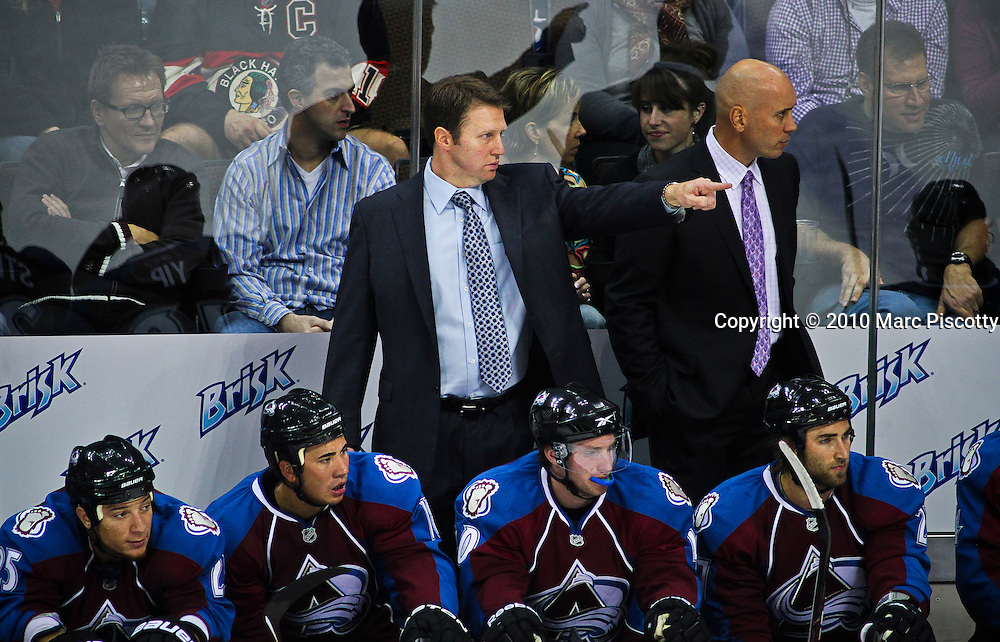 DENVER, CO - OCTOBER 7: Colorado Avalanche head coach Joe Sacco makes a few adjustments from behind the bench against the Chicago Blackhawks during both team's season openers at the Pepsi Center on October 7, 2010 in Denver, Colorado. The Avalanche won the game 4-3 in overtime. (Photo by Marc Piscotty / © 2010)