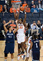 Virginia center Aisha Mohammed (33) grabs a rebound against Rhode Island.  The Virginia Cavaliers women's basketball team defeated the Rhode Island Rams 89-53 at the John Paul Jones Arena in Charlottesville, VA on January 9, 2008.