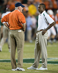 Virginia head coach Al Groh talks with Miami head coach Randy Shannon before the start of the game.  The #19 Virginia Cavaliers defeated the Miami Hurricanes 48-0 at the Orange Bowl in Miami, Florida on November 10, 2007.  The game was the final game played in the Orange Bowl.