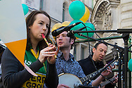 An Irish folk music band plays during the St Patrick's Day Parade in Westminster, London.<br /> Picture by Paul Davey/Focus Images Ltd +447966 016296<br /> 13/03/2016