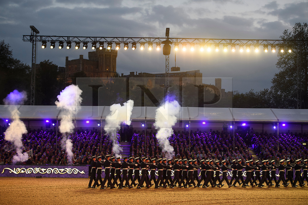 © Licensed to London News Pictures. 15/05/2016. Windsor, UK.  Windsor Castle seen in the background of the area. An evening event held at the Royal Windsor Horse show to celebrate the 90th birthday of HRH Queen Elizabeth II. Acts from arounds the world have been invited to perform at the evening event, set in the grounds of Windsor Castle. Photo credit: Ben Cawthra/LNP
