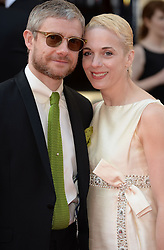 Martin Freeman with Amanda Abbington arrives for the BAFTA TV Awards at the Theatre Royal, London, United Kingdom. Sunday, 18th May 2014. Picture by Andrew Parsons / i-Images