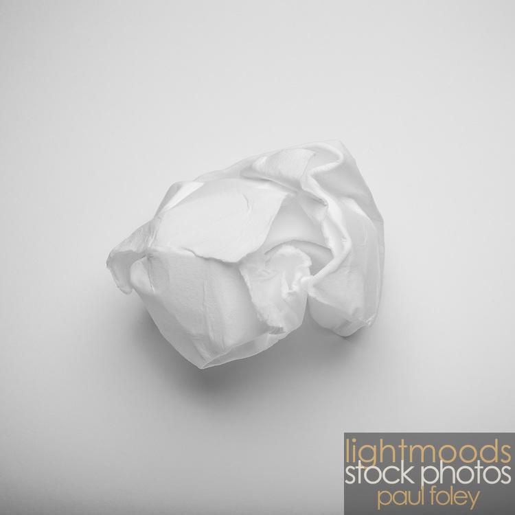 Cotton rag art paper crumpled onto cotton rag art paper.