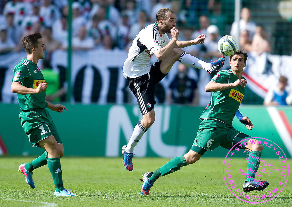 (C) Legia's Danijel Ljuboja fights for the ball with (R) Lechia's Jaroslaw Bieniuk during T-Mobile Extraleague soccer match between Legia Warsaw and Lechia Gdansk at Pepsi Arena in Warsaw, Poland...Poland, Warsaw, May 05, 2013..Picture also available in RAW (NEF) or TIFF format on special request...For editorial use only. Any commercial or promotional use requires permission...Photo by © Adam Nurkiewicz / Mediasport
