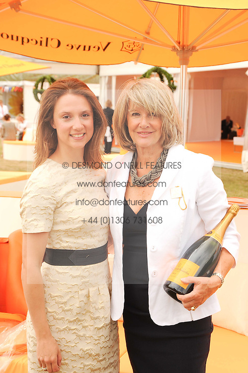 Left to right, VICTORIA HIGGINS and her mother LIZ HIGGINS at the Veuve Clicquot Gold Cup polo final held at Cowdray Park, Midhurst, West Sussex on 18th July 2010.