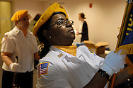 "14 MAY 2011 -- ST. LOUIS -- Veterans Darlene Coats (right) and Beth Gonzales of American Legion Post 404 prepare to present the colors at the ""Women Veterans Stand Down"" information fair held Saturday, May 14, 2011 at the Busch Center on the St. Louis University Campus in St. Louis. Image © copyright 2011 Sid Hastings."