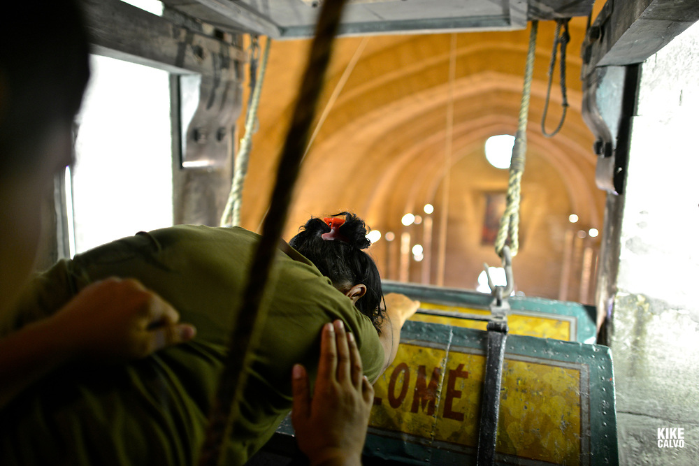 """A reduced number of people, many belonging to the same Gypsies families, are allowed into the """"High Chapel"""" . A private and special ceremony brings down he reliquaries containing the relics of Patron saint of the Gypsies Sara using a winch."""