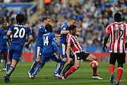 Southampton forward Graziano Pelle (19)  shields the ball  during the Barclays Premier League match between Leicester City and Southampton at the King Power Stadium, Leicester, England on 3 April 2016. Photo by Simon Davies.