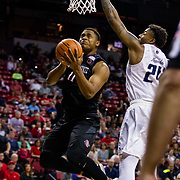 09 March 2018: San Diego State men's basketball takes on Nevada in the quarterfinal round of the Mountain West Conference Tournament. San Diego State Aztecs forward Matt Mitchell (11) goes up for a layup while being defended by Nevada Wolf Pack guard Jordan Caroline (24) in the first half. The Aztecs cruise past the Wolfpack 90-73 to move on to the Championship game tomorrow afternoon at 3pm.<br /> More game action at www.sdsuaztecphotos.com